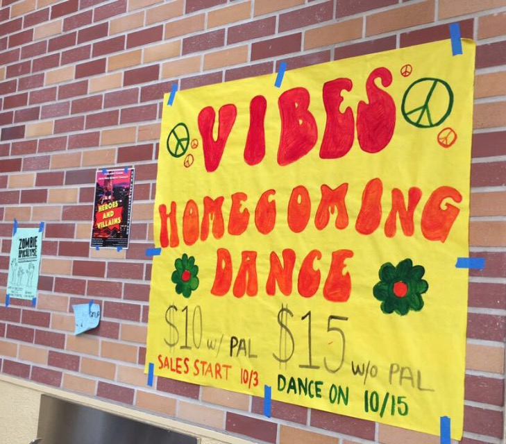 ASB+puts+up+posters+advertising+the+homecoming+dance%2C+which+will+take+place+on+Oct.+15.+