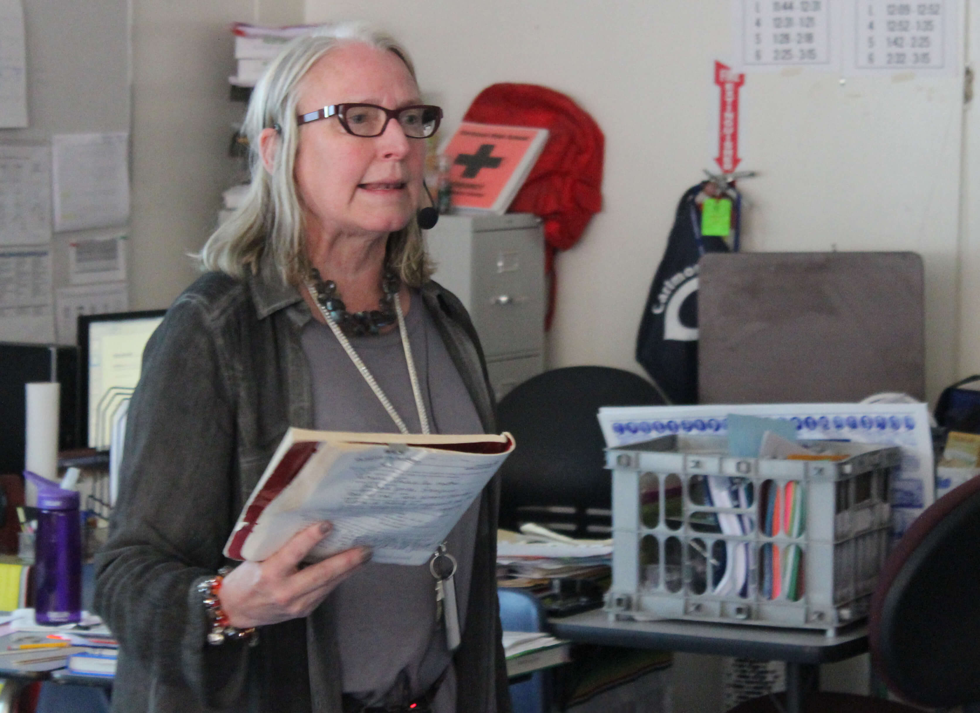 Foreign language teacher Roberta Scott speaks into a microphone when she teaches in order to project her voice over the sound produced by the construction outside of her classroom.