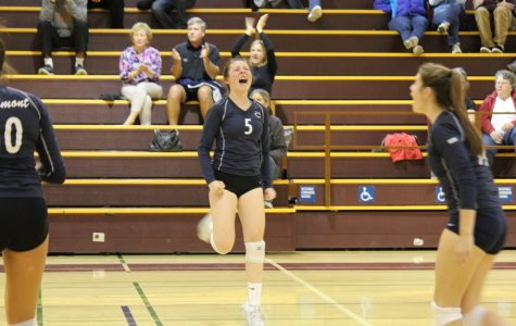 Senior Hannah Wright celebrates her point despite Carlmont's deficit.