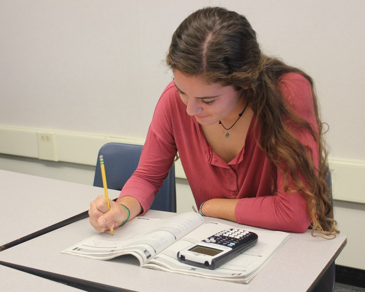 Eleventh-grader Angela Grundig studies for the PSAT using a booklet that Carlmont provided.