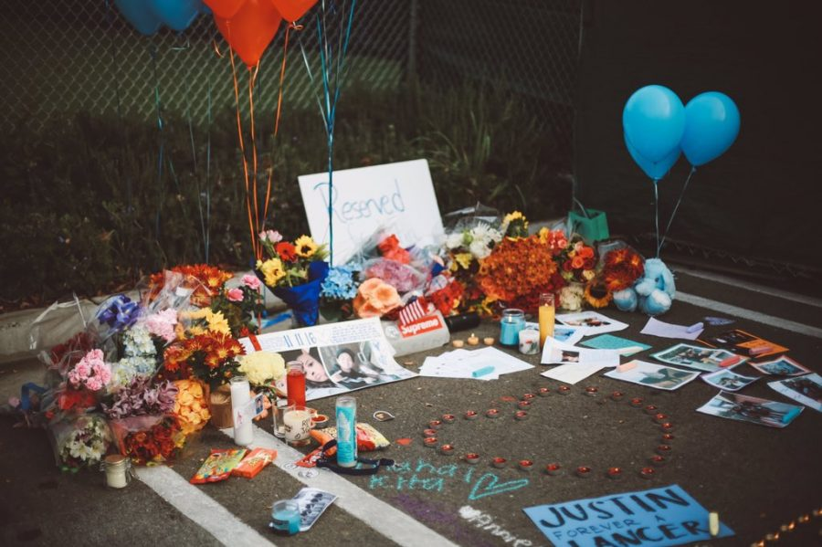 In the Saint Francis parking lot, students created a memorial for Justin Quintos.