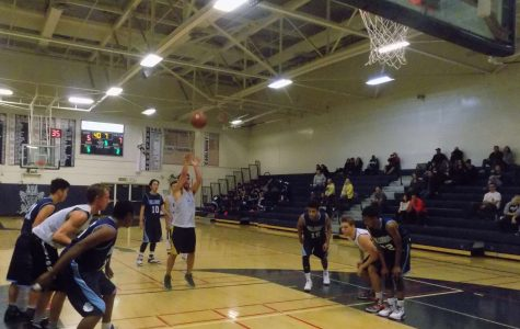 Junior Elliot Reidy shoots a free throw after being fouled in Carlmont's first scrimmage.