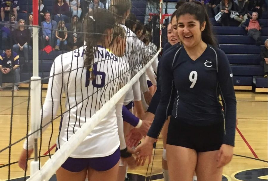 Senior Roz Soheili shakes hands with players from Salinas High School prior to the match.