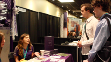 Many students attend college fairs to get an idea of what college is best for them. A representative from Kansas State University speaks with students interested in video production.