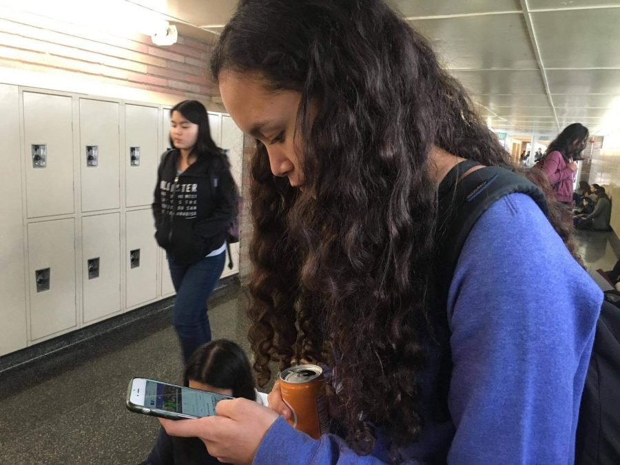 Sophmore Kimi Eng reads through the Carlmont meme page during lunch.