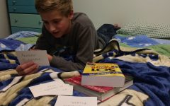 Freshman Aidan Truel studies a deck of flashcards with Spanish vocabulary about airports.
