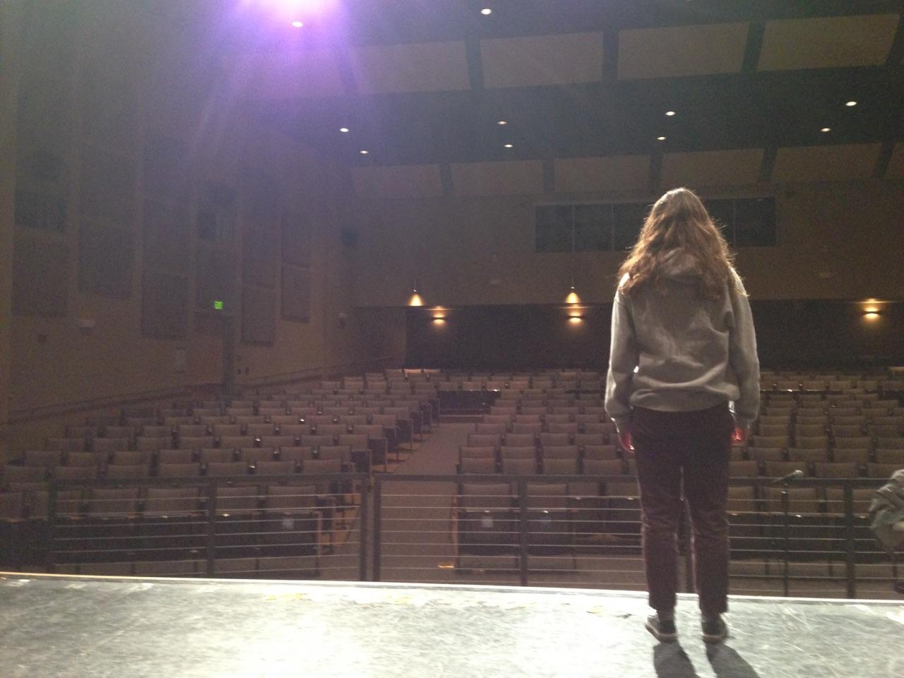 Meilene Jones, a junior, practices performing on stage in Carlmont's performing arts center.