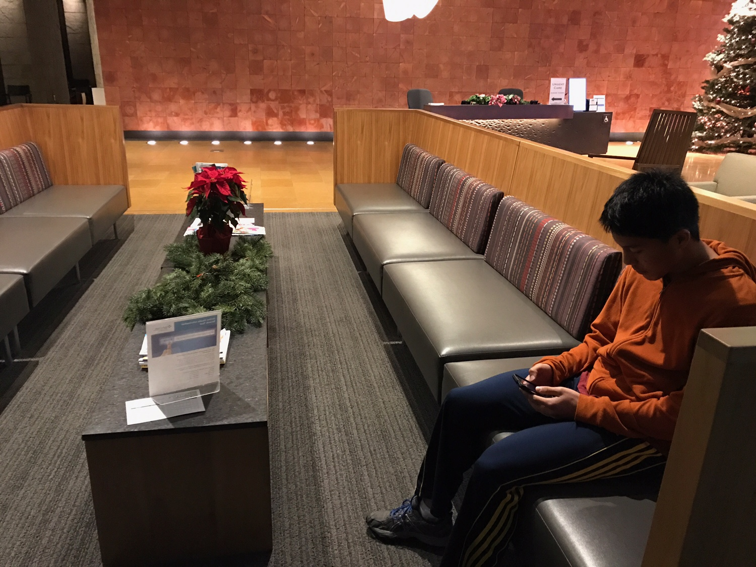 Sophomore Justin Hsu  waits for his doctor to show up at the Palo Alto Medical Foundation in San Carlos.