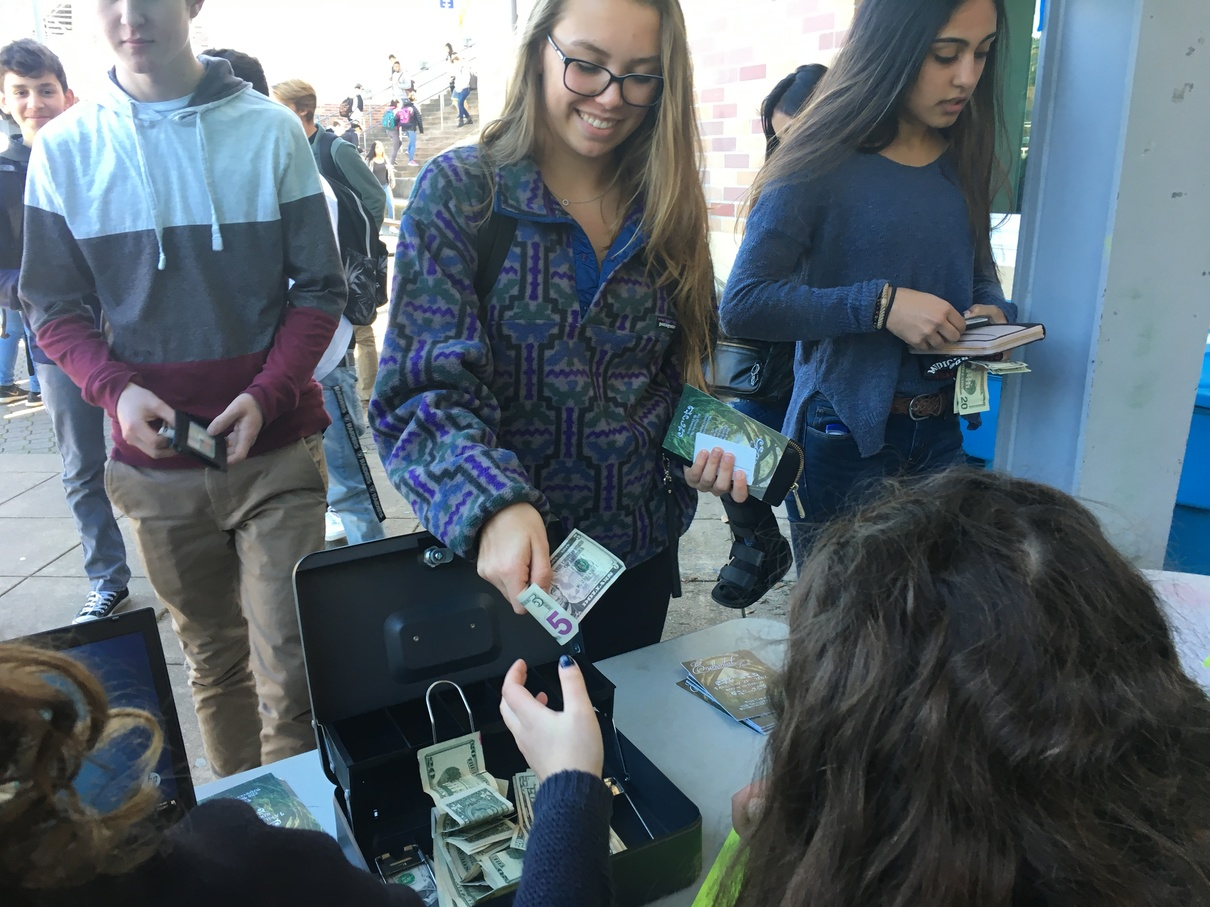 Eleventh-grader Kristina Dvorak buys a ticket for Winter Formal to spend a night with friends.