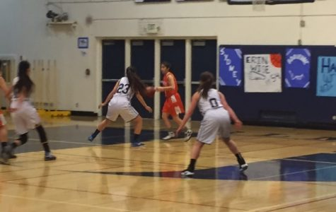 Carlmont puts up a tough defense against Woodside in their game.