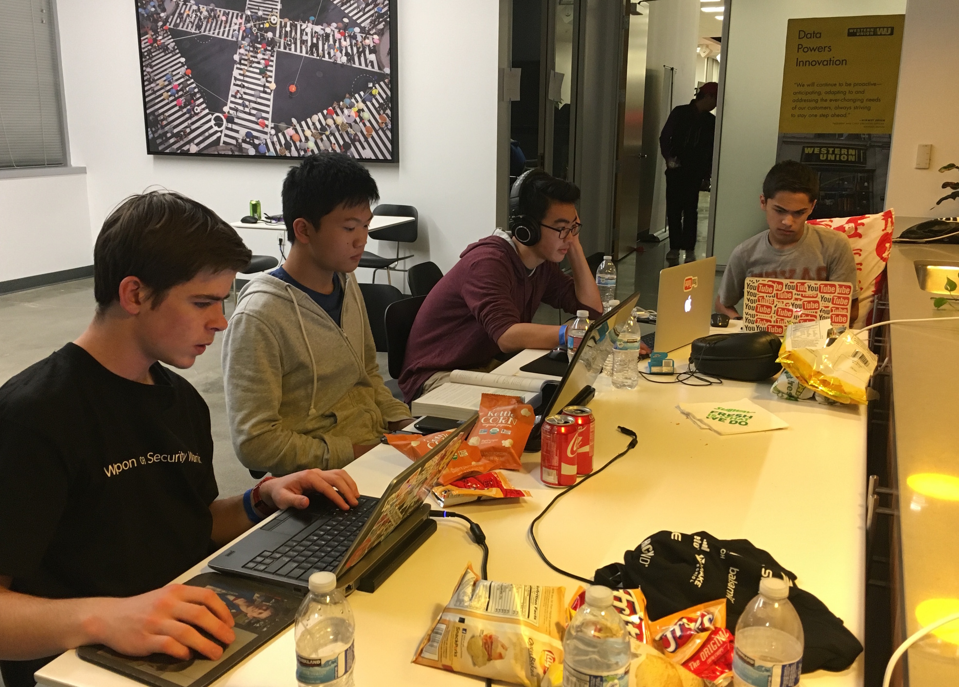 A+group+of+hackers+work+on+their+projects+through+the+night.