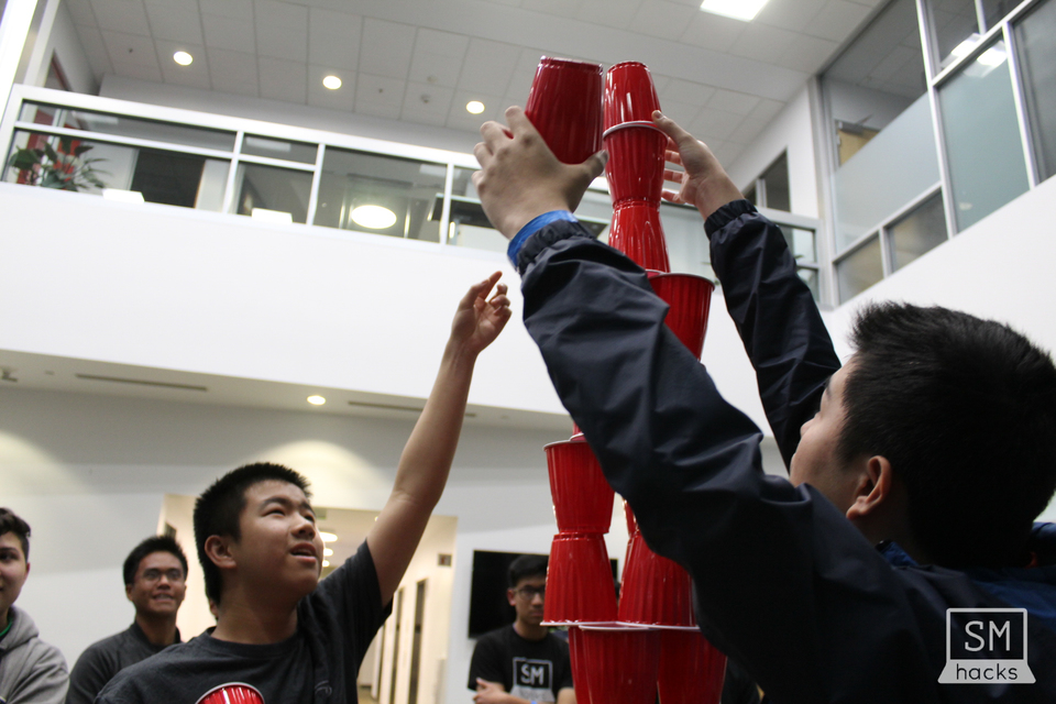 To+give+hackers+a+break%2C+organizers+held+a+cup+stacking+tournament.+Teams+worked+in+pairs+to+build+the+tallest+tower.+The+top+two+teams+would+win+drones+for+each+member.