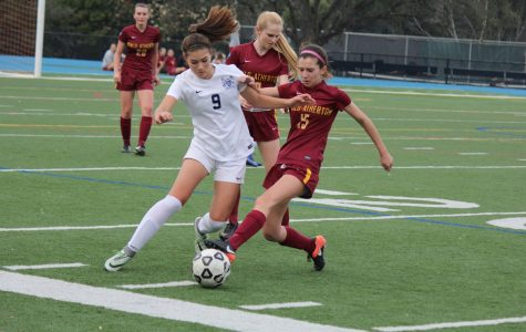 Freshman Kyla Orthbandt gets by the defensive line in attempts to score.