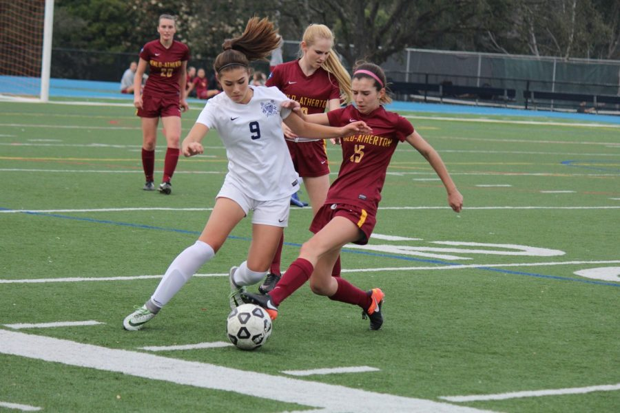 Freshman+Kyla+Orthbandt+gets+by+the+defensive+line+in+attempts+to+score.