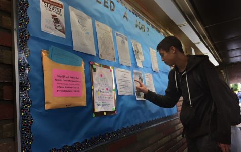 Ryan Kee, a sophomore, searches the job board for work and a place to make connections in the community.