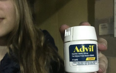 Téa Pusey, a junior, uses advil to deal with the pain she experiences on a regular basis.