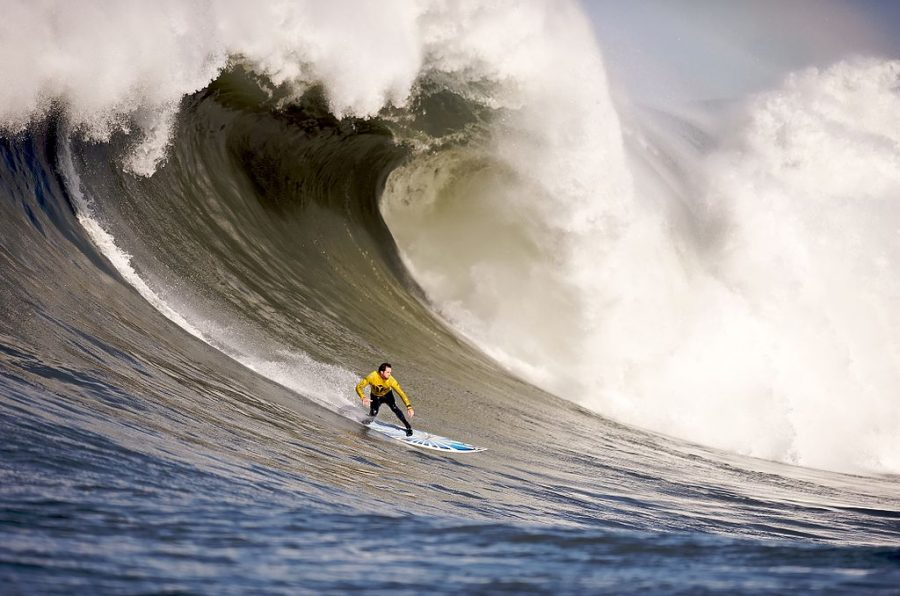 Greg Long surfs a massive wave at Mavericks in Half Moon Bay.