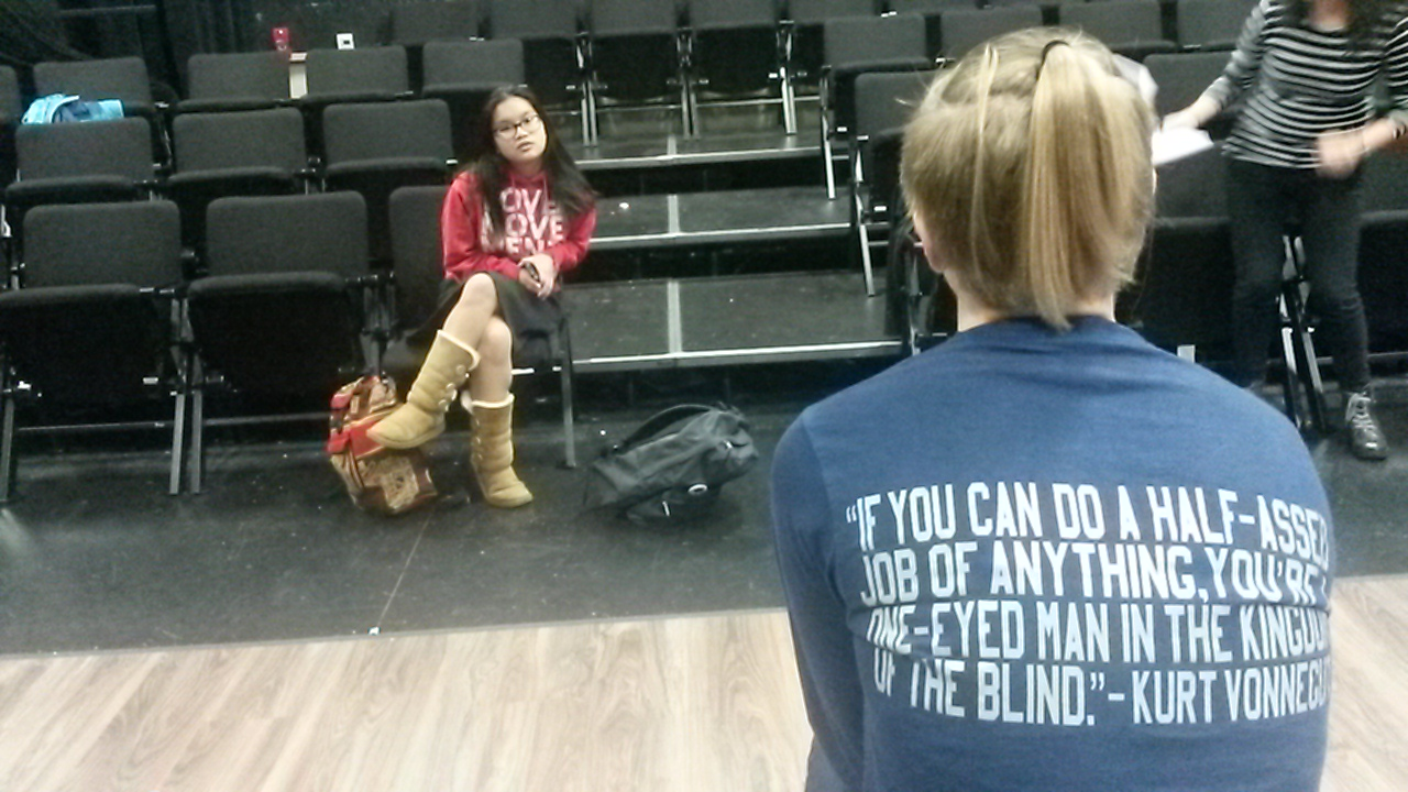 Julia Clark, a junior, recites her monologue in front of  Chesirae Barbano, a senior.