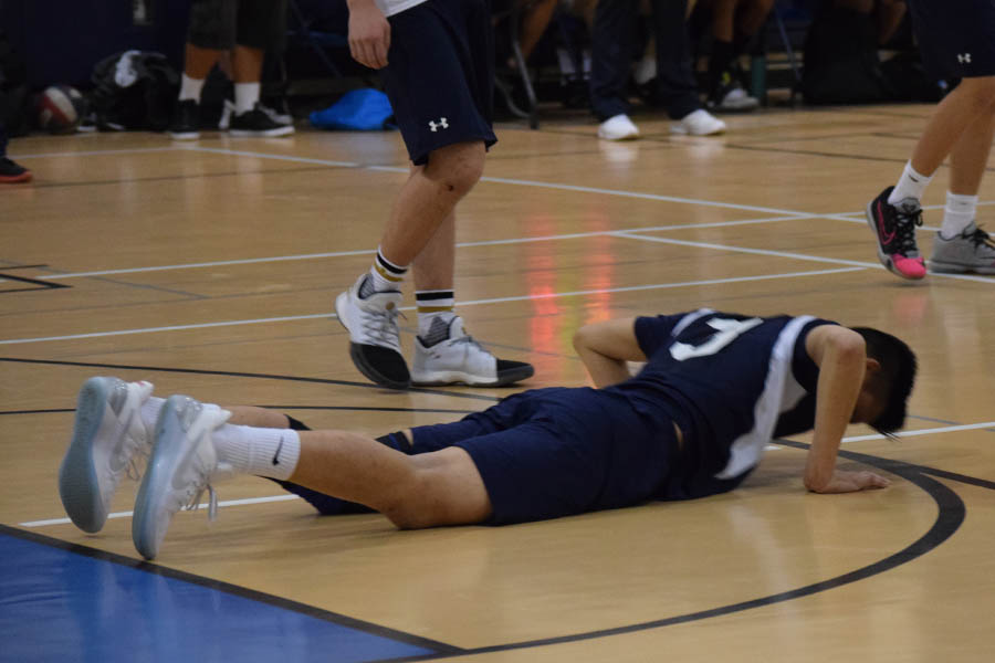 Chris Ding, a senior, dives in an attempt to save the ball but fails.