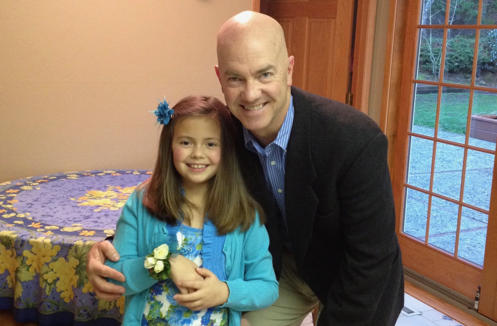 Mike Davies and his, at the time, 9-year-old daughter Senna pose for a photo before the Father-Daughter Sweetheart Dance.