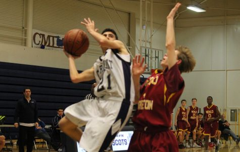 A Carlmont Scots  goes up for a layup against a tough Menlo-Atherton defense.