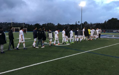JV Boys Soccer lines up to shake hands with Aragon after a 5-1 defeat.