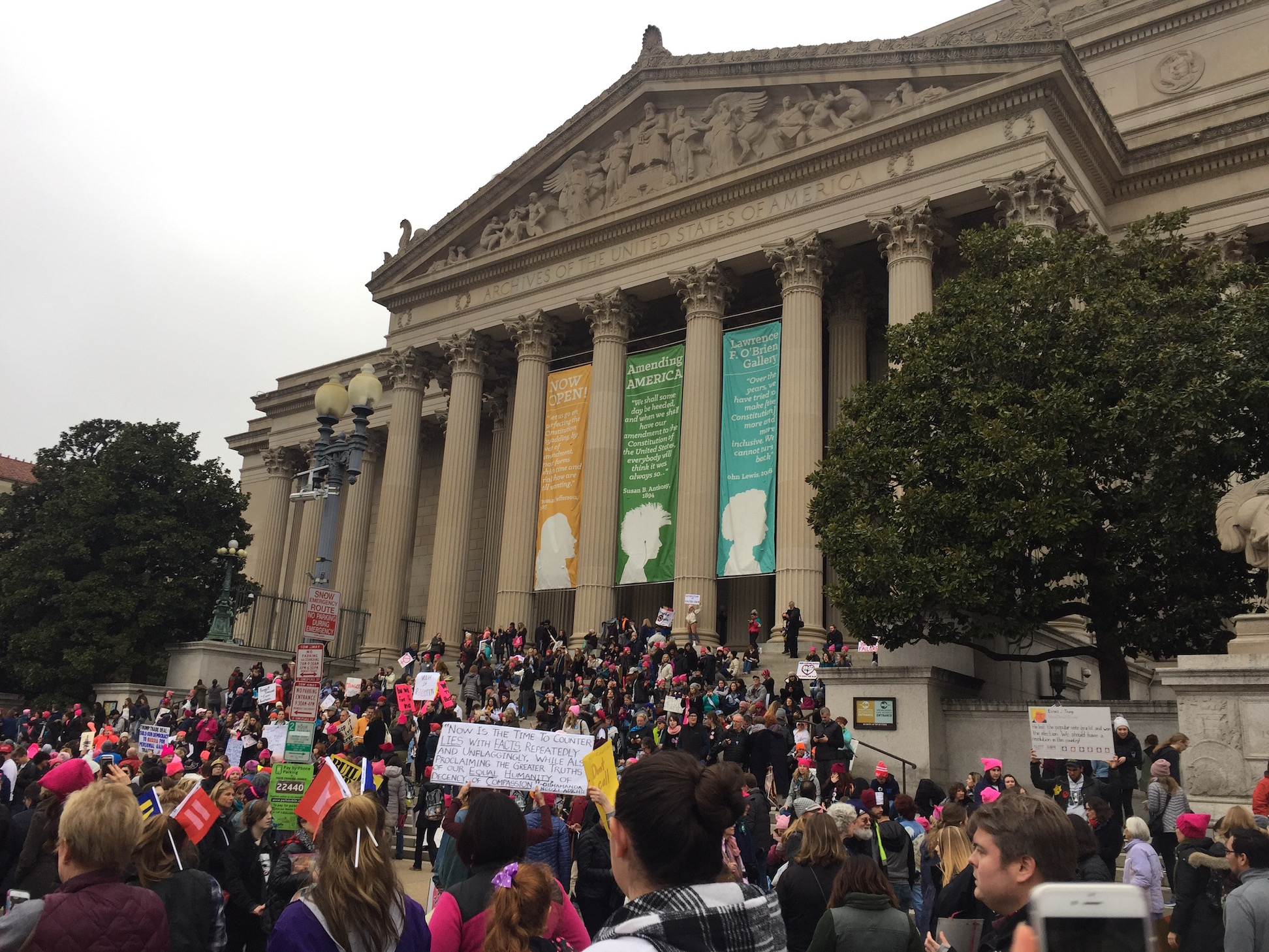 Protesters+gather+on+the+steps+of+a+museum.