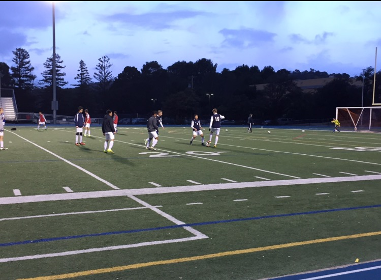 The+Varsity+Soccer+team+warms+up+for+their+game+with+a+scrimmage+on+the+field.