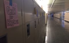 Hand drawn posters from the publicity commission are hung on lockers in C-hall.