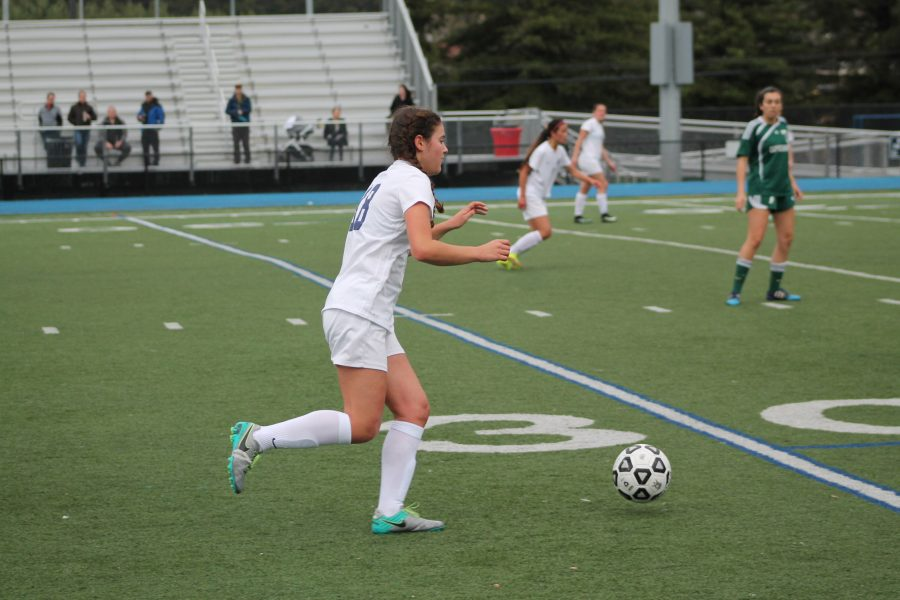 Junior Angela Grundig prepares to kick the ball up the field to her teammates.