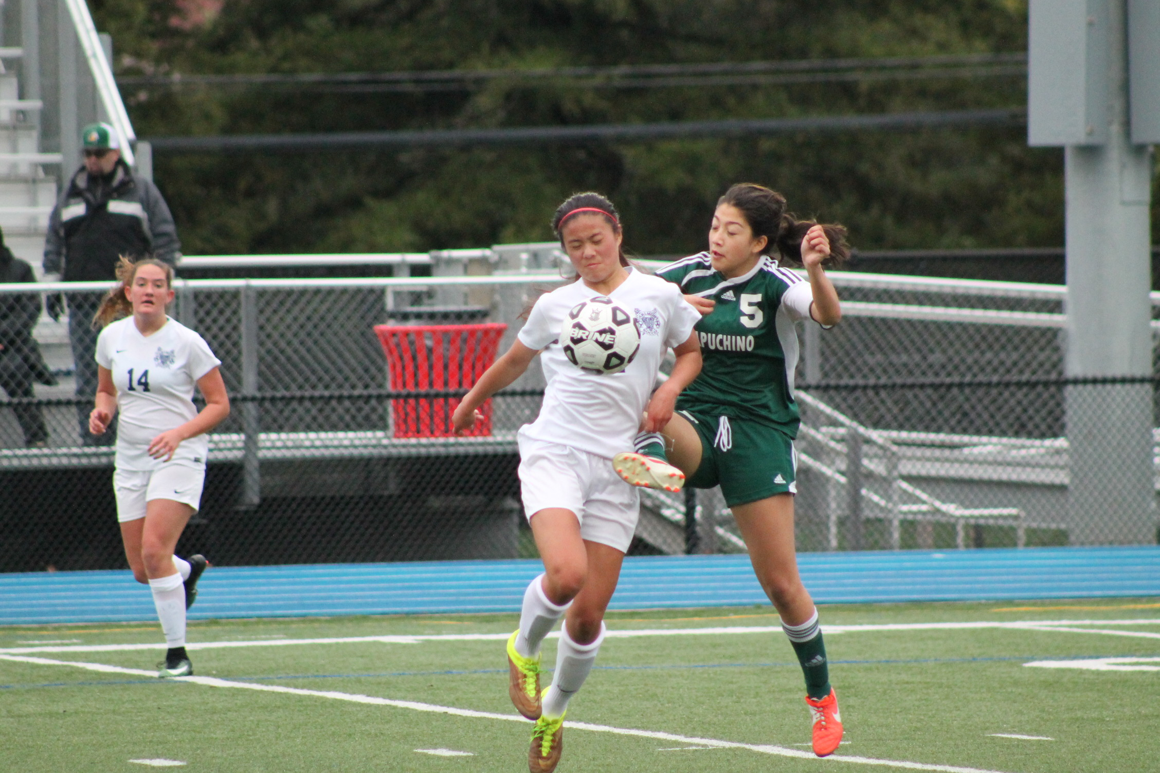 Freshman Samantha Phan pushes past a Capuchino defender on her way to the goal. Phan scored 2 goals during the game against Capuchino.