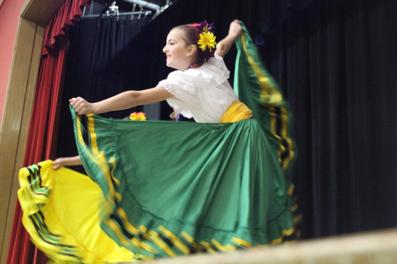 Amanda Barrish, a 10 year old, performs a Mexican folk dance at the Belmont talent show.