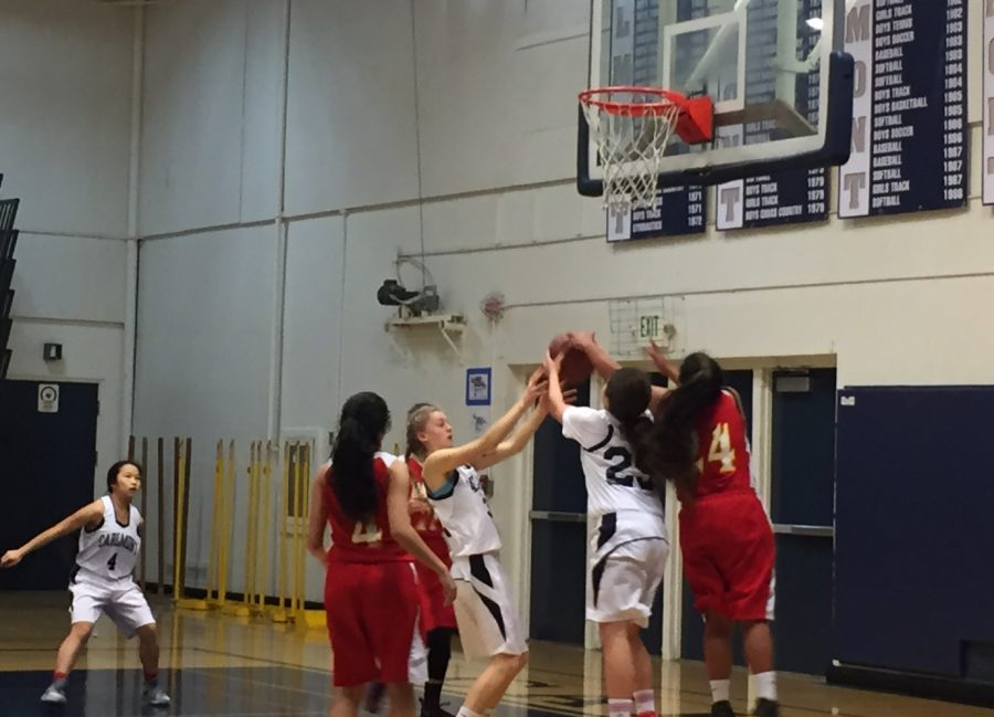Frshman Ava Bruckner Kocknel helps block a shot in the fourth quarter.