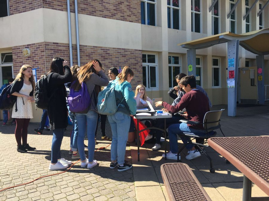 ASB students give up their lunch to run sign-ups for the upcoming blood drive and encourage fellow peers to participate.