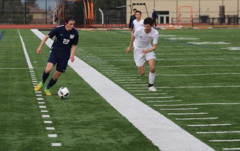 Leo McBride, a senior, dribbles down the field.