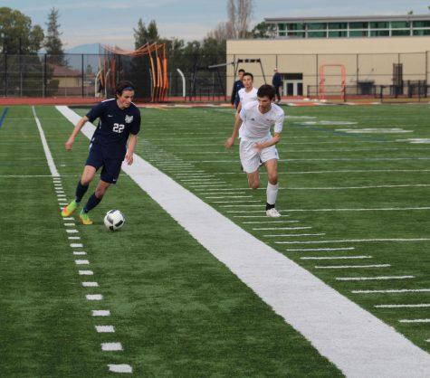 Leo McBride, a senior, dribbles down the field.