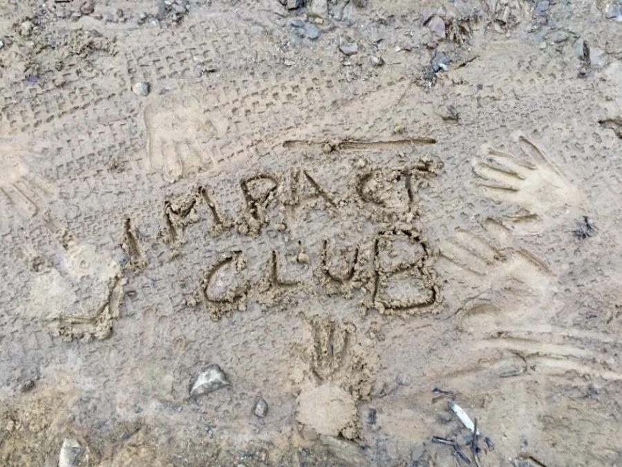 At+the+first+IMPACT+Club+meeting%2C+students+imprinted+their+hands+on+the+muddy+ground%2C+marking+the+start+of+the+new+club.