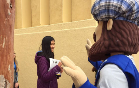 Monty gives a high five to an incoming freshman.
