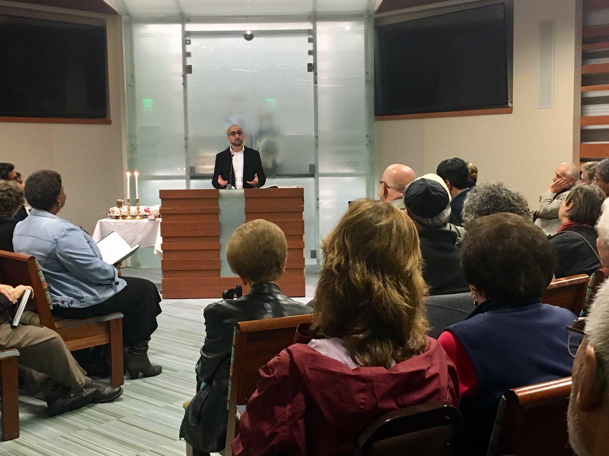 Yazan Ibrahim gives the sermon at a Friday night service at Peninsula Temple Sholom.