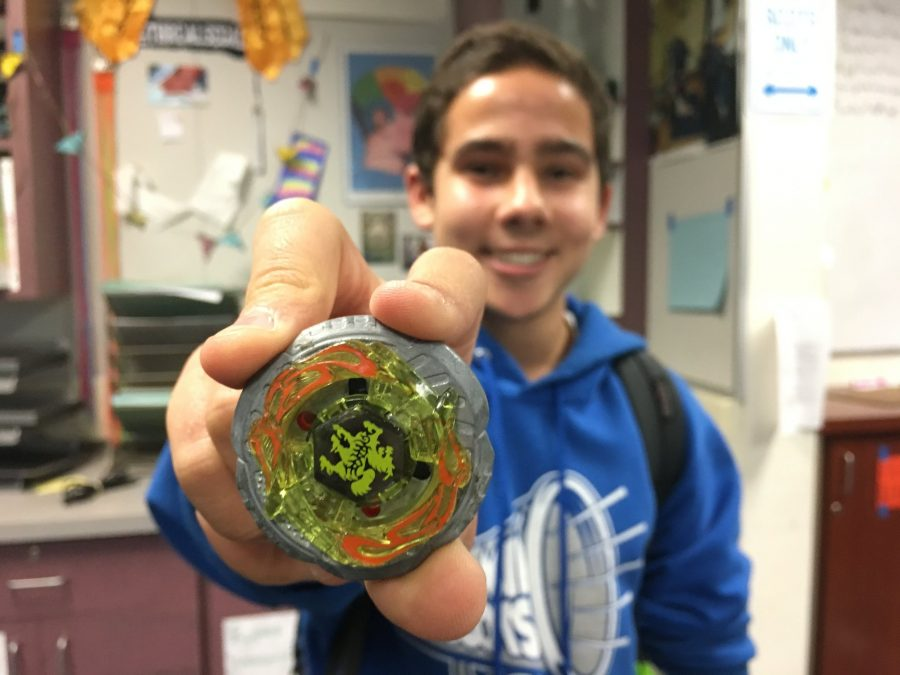 Sophomore+Kyle+Dimick+presents+the+Beyblade+that+he+hopes+will+bring+him+to+victory+in+the+upcoming+tournament.