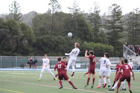Boys varsity defends home turf in thriller