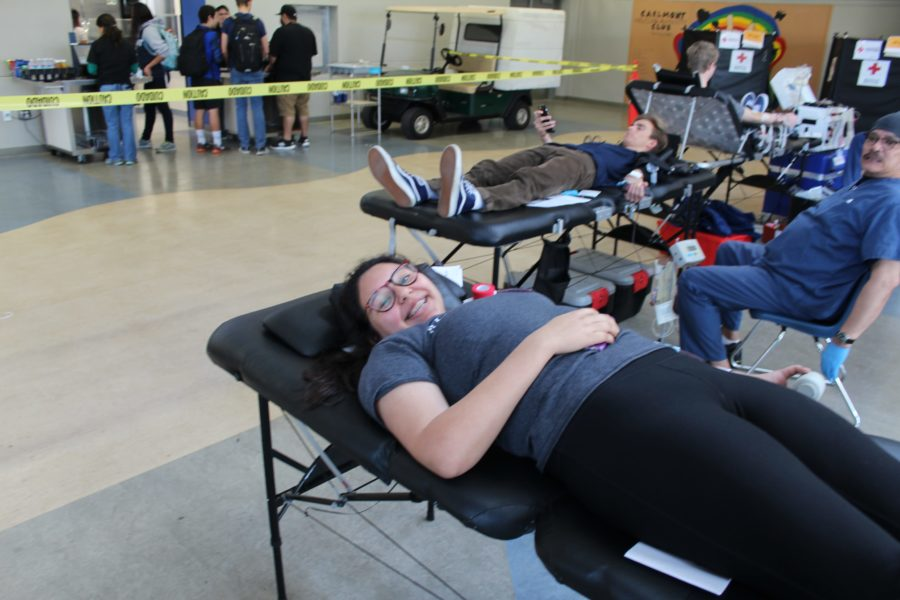 Samantha Torres, a junior, lies on the table as she gives blood.