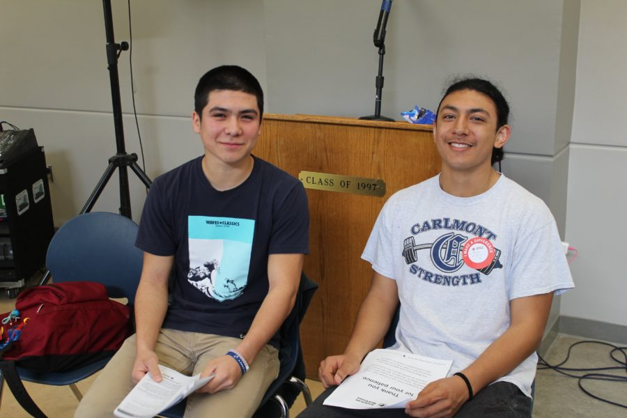Anthony Arteaga and Noel Arzate, both juniors, read the necessary materials while they wait to donate blood.