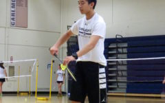 Sophomore Alexander Wang serves to his opponent.