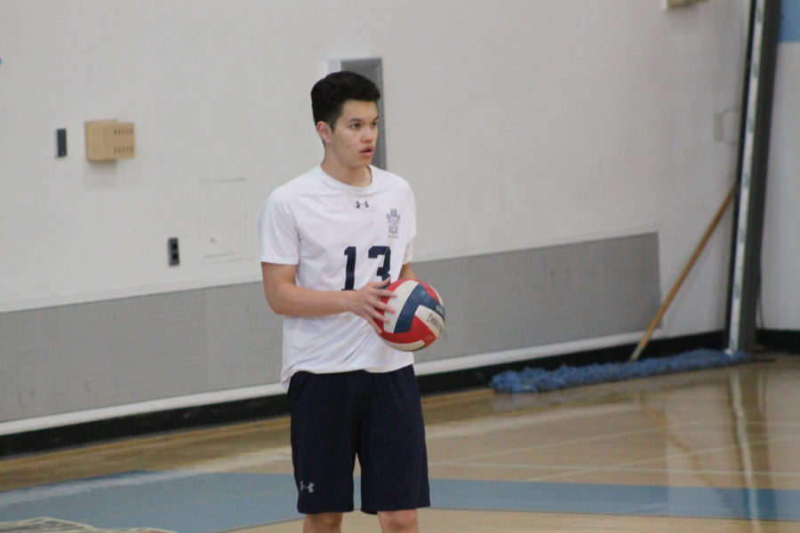James Houston, a junior, prepares to serve during Carlmont's warm ups.