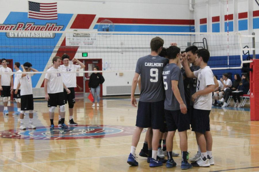 Carlmont%27s+starting+six+form+huddle+to+motivate+themselves+and+focus+on+the+game.+Carlmont+beat+Hillsdale+High+School+in+three+sets+on+March+20.
