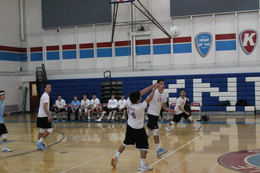 Hillsdale player bumps the ball over the net in their match against Carlmont.
