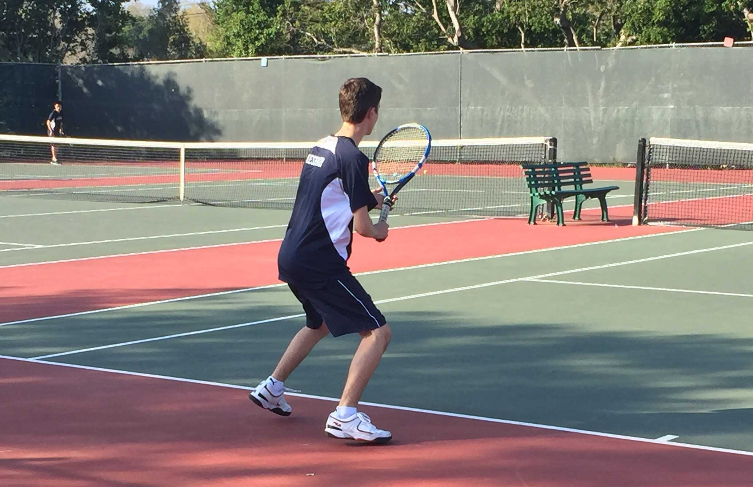 Doubles player Alexander Kessler, a junior, prepares to return his opponent's serve.