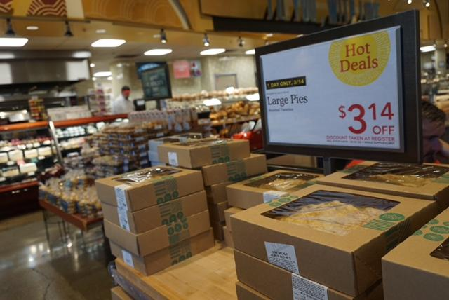 Pies+at+Whole+Foods+were+sold+at+%243.14+off+in+celebration+of+Pi+Day.