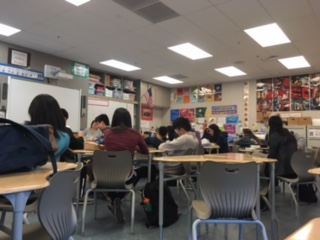 Members of Chinese Culture Club discuss future events and the election of new officers.